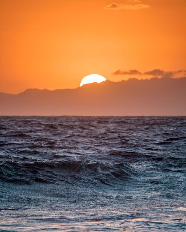 sunrise over beach ocean orange glowing sky